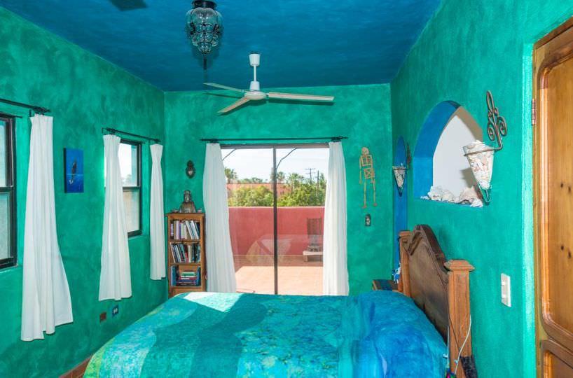 Casa Sueño de Colores bedroom with glass doors to terrace