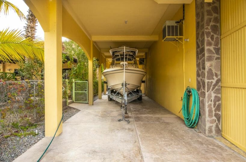 Four bedroom home in Loreto on large lot with sea and mountain views: boat carport.