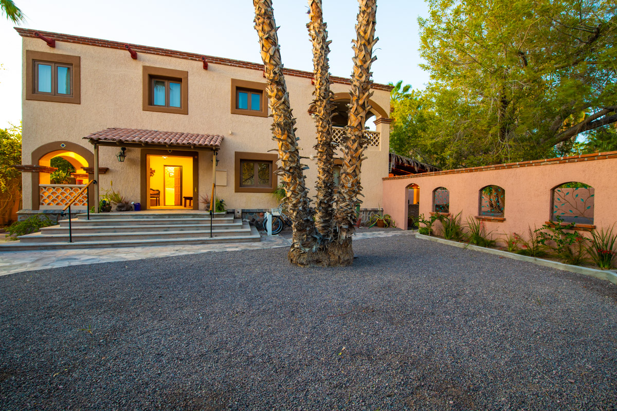 Beautifully restored four bedroom adobe home Front of Casa at dusk