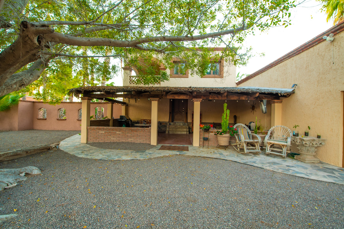 Beautifully restored four bedroom adobe home covered back porch