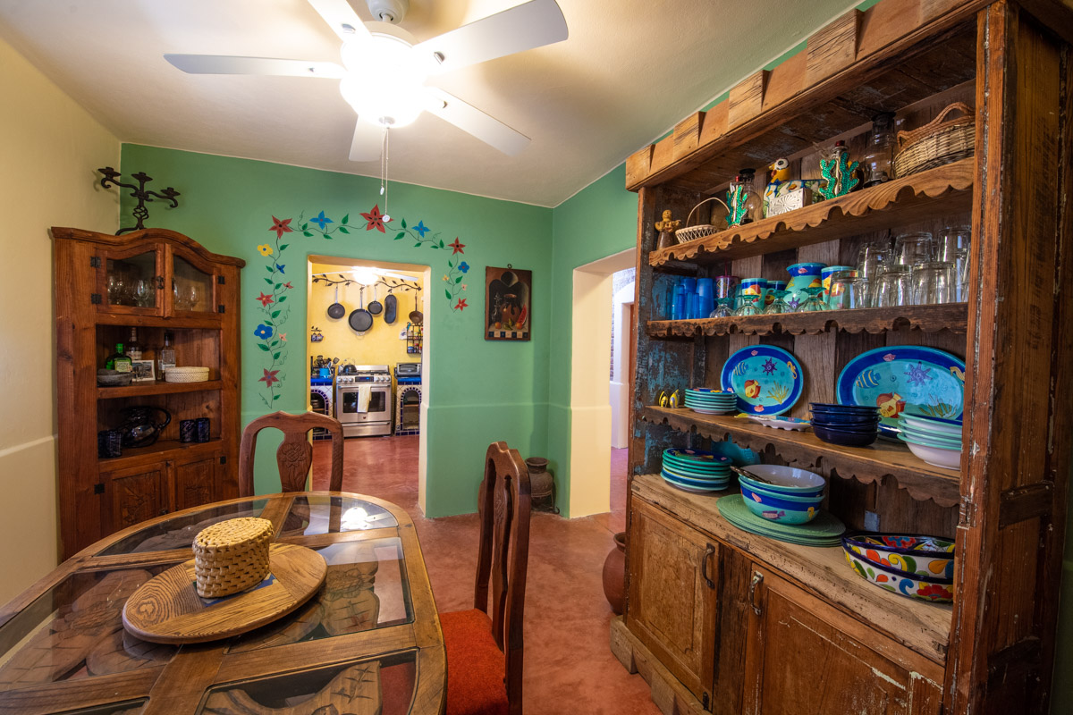 Beautifully restored four bedroom adobe home dining looking into kitchen