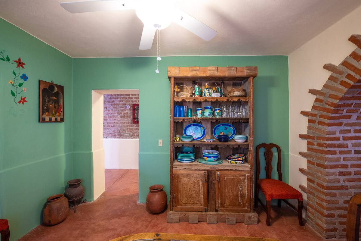 Beautifully restored four bedroom adobe home dining room looking to hallway