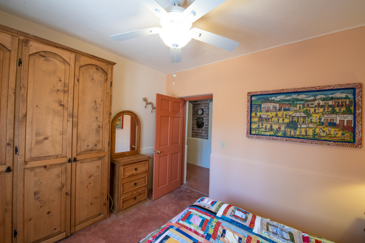 Beautifully restored four bedroom adobe home downstairs bedroom looking North.