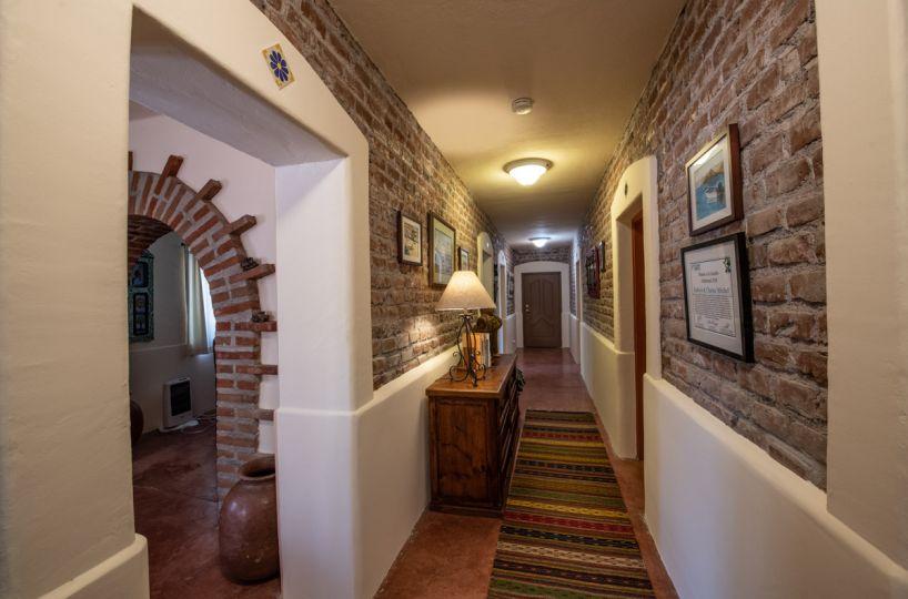 Beautifully restored four bedroom adobe home downstairs hallway looking East