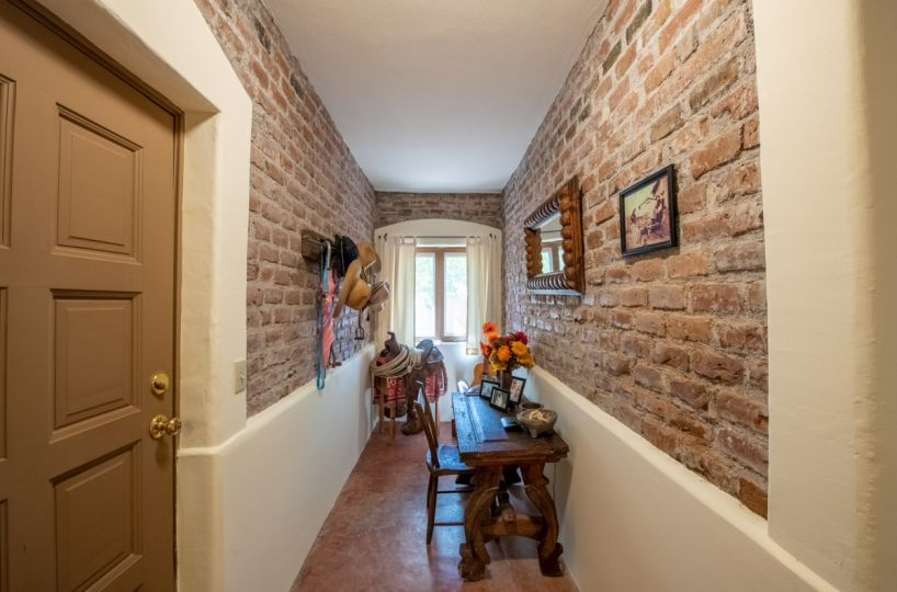 Beautifully restored four bedroom adobe home downstairs hallway looking West