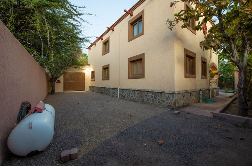 Beautifully restored four bedroom adobe home driveway and garage