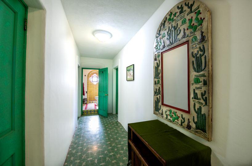 Beautifully restored four bedroom adobe home upstairs hallway looking West