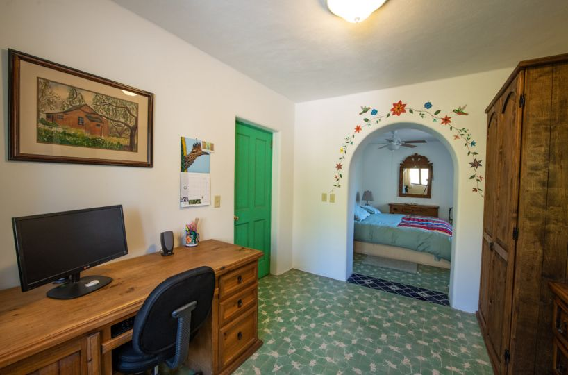 Beautifully restored four bedroom adobe home upstairs office looking into bedroom